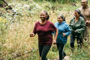 seniors enjoying walk on Cedar Community's large campus
